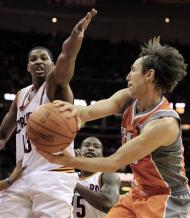 Phoenix Suns' Steve Nash, right, passes against Cleveland Cavaliers' Tristan Thompson during the first quarter in an NBA basketball game, Sunday, March 25, 2012, in Cleveland. (AP Photo/Tony Dejak)