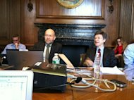 Climate scientists James Hansen (left) and economist Jeffrey Sachs discuss a new paper on limiting carbon dioxide emissions with reporters at Columbia University's Low Library on Dec. 3, 2013.