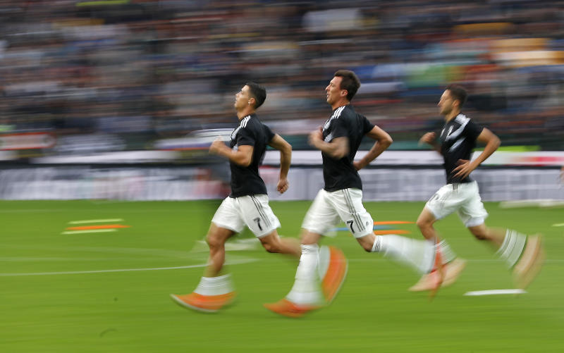 Juventus' Cristiano Ronaldo, left, warms up with his teammates prior to the start of the Serie A soccer match between AC Udinese and Juventus at the Dacia Arena Stadium, in Udine, Italy, Saturday, Oct. 6, 2018. (AP Photo/Antonio Calanni)