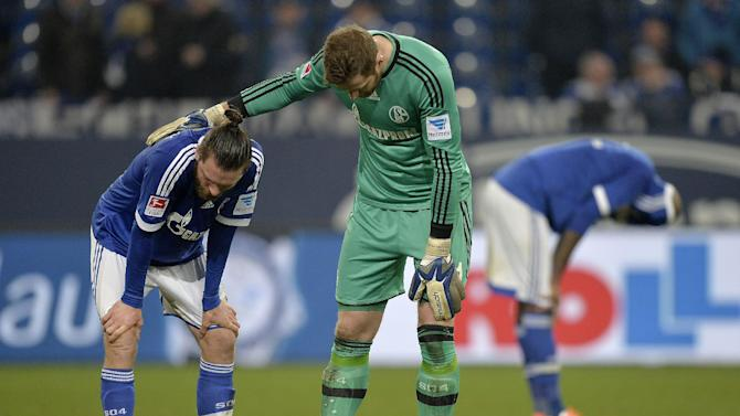 Schalke goalkeeper Ralf Faehrmann comforts Schalke's Tim Hoogland after the German Bundesliga soccer match between FC Schalke 04 and FSV Mainz 05 in Gelsenkirchen,  Germany, Friday, Feb. 21, 2014. The match ended in a disappointing 0-0