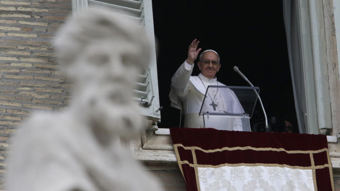 Pope Francis waves before delivering his Angelus prayer from the window of his studio overlooking St. Peter's Square, at the Vatican, Sunday, March 17, 2013. (AP Photo/Gregorio Borgia)