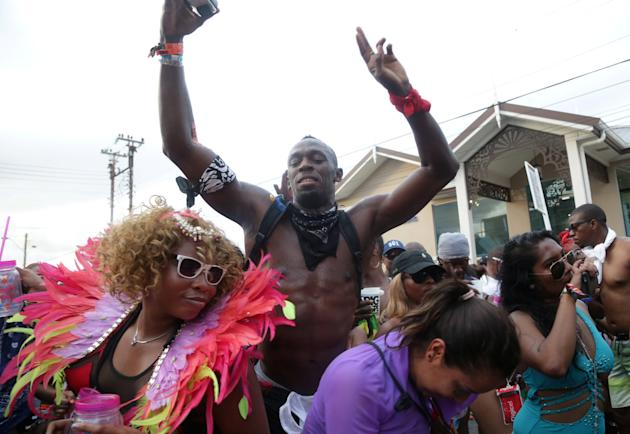 """Jamaica's Olympic champion Usain Bolt plays mas during the presentation of """"Zero Degrees - The Life Below"""" by TRIBE during carnival celebrations in Port-of-Spain, Trinidad and Tobago"""