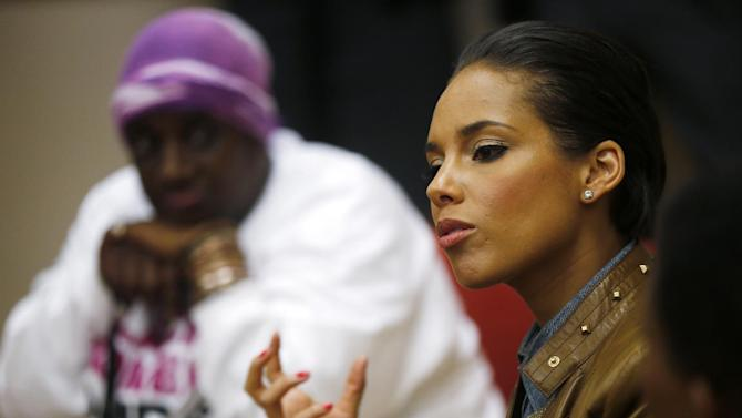 "Grammy Award-winning singer Alicia Keys speaks as she visits an HIV women's support group at United Medical Center in Washington, Monday, April 15, 2013. Keys is working with the Kaiser Family Foundation for ""Empowered,"" a campaign launched last month to educate women about HIV/AIDS and provide grants to community based projects that will do that. (AP Photo/Charles Dharapak)"