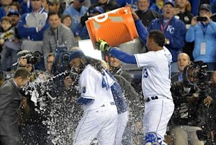 Johnny Cueto is dunked with a cooler of water after pitching a complete game. (USA Today)