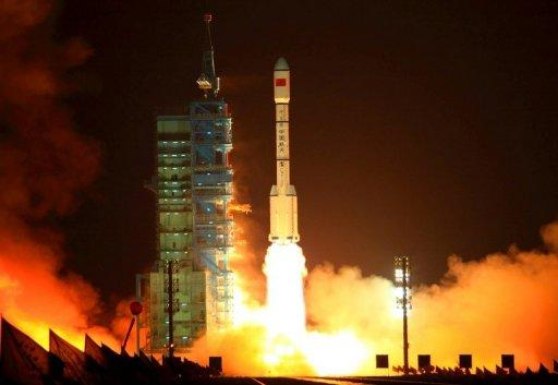 This file photo shows a China's Long March rocket blasting off from the Jiuquan launch centre in Gansu province, on September 29, 2011. China has launched commercial and public services across the Asia-Pacific region on its domestic satellite navigation network built to rival the US global positioning system.