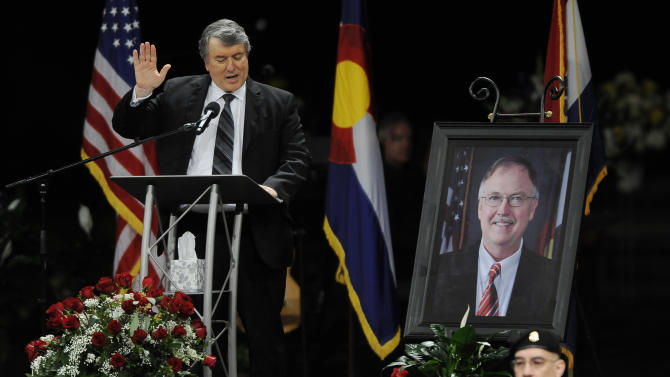 George Lombardi, left, leads other corrections official in swearing an oath to follow the ideas of Tom Clements during a public memorial for the chief executive of the Colorado Department of Corrections at New Life Church in Colorado Springs, Colo., on Monday, March 25, 2013. Corrections officials and guards from as far away as Morocco are among the hundreds of people who turned out Monday to honor Clements, killed March 19 when he answered the door of his home in a wooded, rural area north of Colorado Springs. (AP Photo/The Gazette, Jerilee Bennett, Pool)