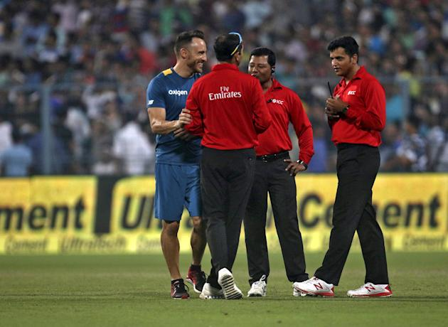 South Africa's captain du Plessis speaks with umpires Chaudhary, Shamshuddin and Kulkarni on the outfield after the rain delayed the third and final Twenty20 cricket match between India and South