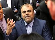 Iran's minister of Petroleum, Rostam Ghasemi, arrives for the 161st meeting of the OPEC in Vienna, on June 14. A European Union embargo on Iranian oil went into effect on Sunday, provoking anger in Tehran which says the measure will hurt talks with world powers over its sensitive nuclear activities