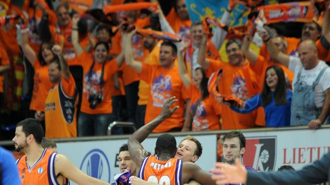 Valencia's Vitor Faverani (1st L), Florent Pietrus (3rd L) And Brad Newley (2nd R) Celebrate Their Victory In An AFP/Getty Images