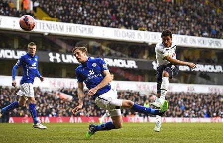 Tottenham Hotspur's Paulinho shoots wide as Leicester City's Andy King challenges  during their FA Cup fourth round soccer match in London