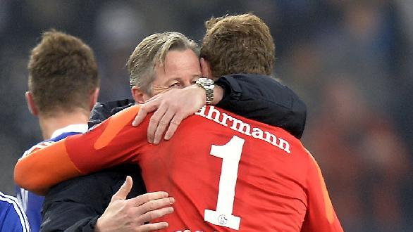 Schalke head coach Jens Keller, left, hugs goalkeeper Ralf Faehrmann after the Champions League Group E soccer match between FC Schalke 04 and FC Basel in Gelsenkirchen, Germany, Wednesday, Dec. 11, 2013. Schalke defeated Basel by 2-0