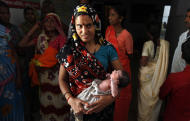 In this photo taken Wednesday, April 13, 2011, a newborn girl is brought to a ward from the operation theater at a government hospital in Morena in the Central Indian State of Madhya Pradesh. The starving girls point to a painful reality revealed in India's most recent census: Despite a booming economy and big cities full of glittering malls and luxury cars, the country is failing its girls. Early results show India has only 914 girls under age 6 for every 1,000 boys. The census in Morena showed that for every 1,000 boys only 825 girls in the district made it to their sixth birthdays, down from an already troubling 829 a decade ago.