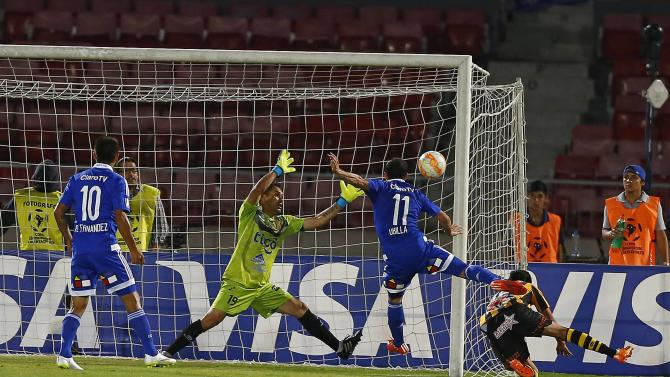 Ubilla of Chile's Universidad de Chile scores a goal as goalkeeper Vaca of Bolivia's The Strongest tries to block during their Copa Libertadores soccer match in Santiago