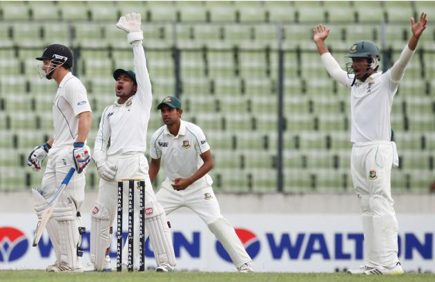 Bangladesh's Rahim and other fielders appeal the dismissal of New Zealand's Watling unsuccessfully, during their third day of second test cricket match of the series in Dhaka.
