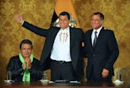 Ecuadorean President Rafael Correa (C) celebrates his re-election flanked by his current Vice-President Lenin Moreno (L) and his Vice-President elect Jorge Glass, at the Carondelet presidential palace in Quito on February 17, 2013. In power since 2007, Correa has taken on big business and media groups, imposed new contracts on oil companies and renegotiated the country's debt