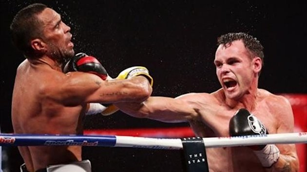 Daniel Geale (R) lands a right on Anthony Mundine (L) during the IBF Middleweight Title bout (Matt King/Getty)