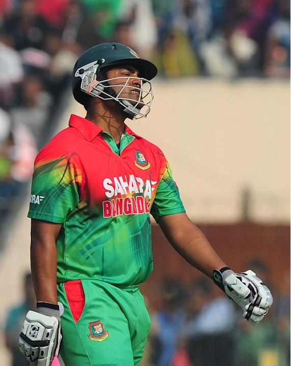 Bangladesh cricketer Tamim Iqbal reacts after begin dismissed  during the first one day international cricket match between Bangladesh and The West Indies at The Sheikh Abu Naser Stadium in Khulna on