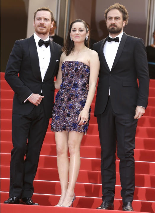 FILE- In this May 23, 2015 file photo, from right, Sean Harris, Marion Cotillard and Michael Fassbender pose for photographers upon arrival for the screening of the film Macbeth at the 68th internatio