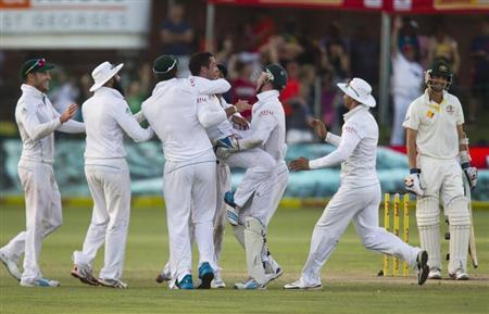 South Africa celebrates after taking the wicket of Australia's Lyon and winning the second test cricket match against Australia in Port Elizabeth