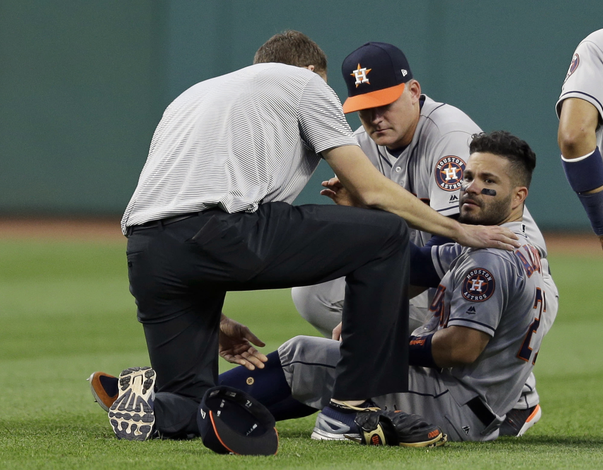 Jose Altuve looks up while receiving medical attention after running into Teoscar Hernandez. (AP Photo/Tony Dejak)