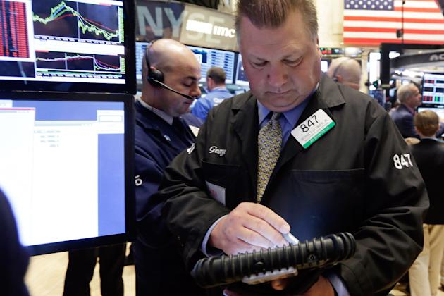 Traders George Ettinger works on the floor of the New York Stock Exchange Monday, April 20, 2015. U.S. stocks are opening higher as more big companies turn in healthy financial results for the first q
