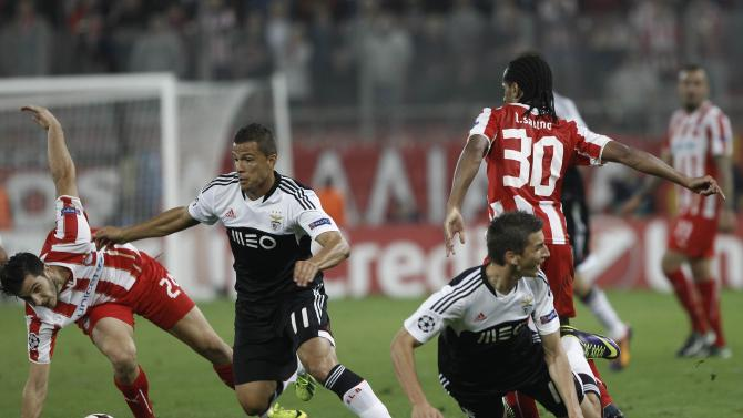 Olympiakos' Manolas fights for the ball against Benfica's Lima during their Champions League soccer match at Karaiskaki stadium in Athens