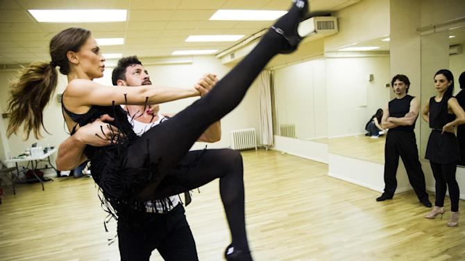 "In this June 28, 2013 photo, dancers Karina Smirnoff, left, and Maksim Chmerkovskiy rehearse for the upcoming Broadway show ""Forever Tango"" as tutors Juan Horvath, second right, and Victoria Galoto, right, look on in New York. Smirnoff and Chmerkovskiy, best known for their work on ""Dancing with the Stars,"" will star in the revival of Luis Bravo's ""Forever Tango,"" which traces the dance's birth on the streets of 19th-century Buenos Aires to its more modern manifestations. (Photo by Charles Sykes/Invision/AP)"