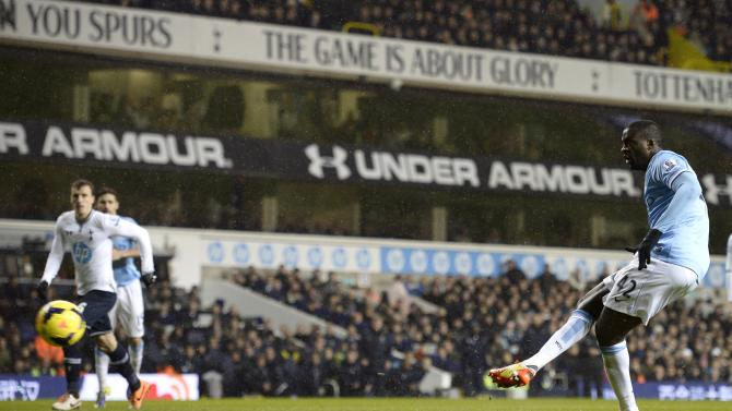 Manchester City's Toure scores a penalty against Tottenham Hotspur during their English Premier League soccer match at White Hart Lane in London