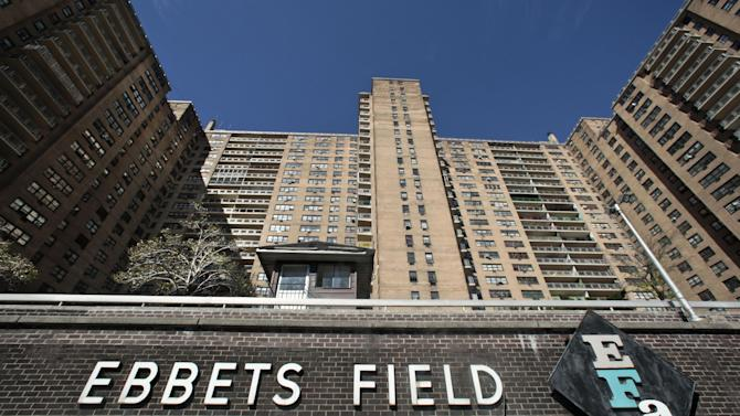 Ebbets Field Apartments, once home to the Brooklyn Dodgers and now home to thousands, is viewed from where second base would have been, Wednesday, Sept. 19, 2012 in Brooklyn, N.Y.  After decades without a professional sports team following the Dodgers move west, Brooklyn is hitting the major leagues again with a new arena and the Brooklyn Nets' NBA franchise.  (AP Photo/Bebeto Matthews)