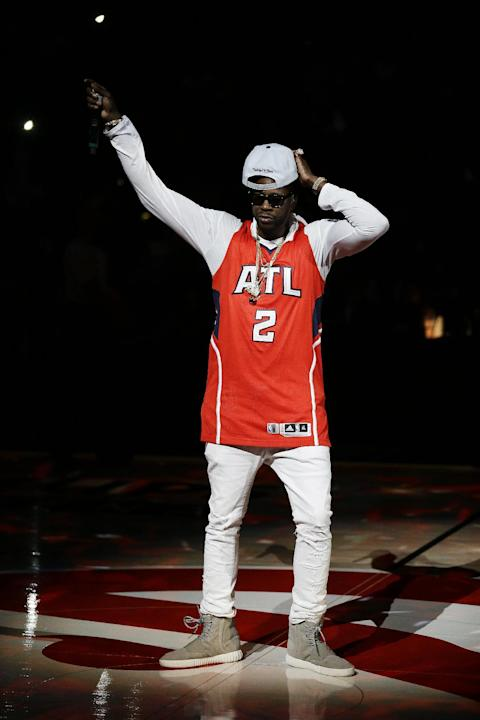 Rap artist 2 Chainz performs before the start of an NBA basketball game between the Atlanta Hawks and the Miami Heat Friday, March 27, 2015, in Atlanta. (AP Photo/David Goldman)
