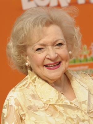 "FILE - In a Sunday, Feb. 19, 2012 file photo, actress Betty White arrives at the premiere of the animated feature film ""The Lorax"" in Universal City, Calif. White is headed to Washington for a Thursday, May 17, 2012 visit. First stop is the Smithsonian Institution, followed by the National Zoo to see the pandas, harmonica-playing elephant and other animals. On Thursday, the 90-year-old actress visits the Smithsonian Associates, an educational division of the museum complex, to discuss her career and longtime passion for animals. She will be signing copies of her book, ""Betty and Friends: My Life at the Zoo.""   (AP Photo/Dan Steinberg, File)"