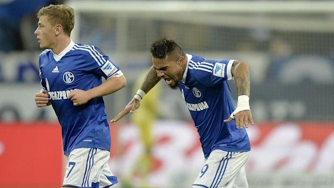 Schalke's Kevin-Prince Boateng, right,  celebrates  behind Schalke's Max Meyer after scoring during the German Bundesliga soccer match between FC Schalke 04 and Werder Bremen in Gelsenkirchen, Germany, Saturday, Nov. 9, 2013