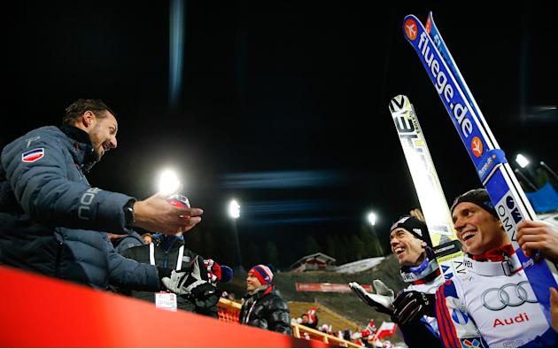 Norway's Crown Prince Haakon celebrates with team Norway winning the men's large hill team ski jumping final at the Nordic World Ski Championships in Falun