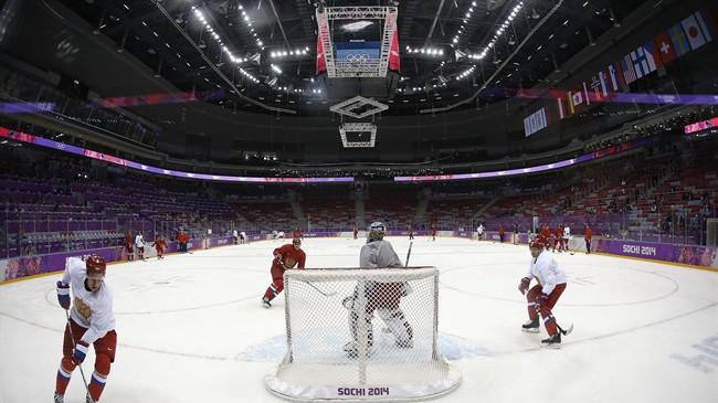 The Russian men's ice hockey team runs through a play during a training session at the 2014 Winter Olympics, Monday, Feb. 10, 2014, in Sochi, Russia. (AP Photo/Julie Jacobson)