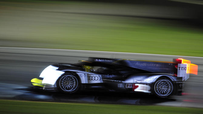 Tom Kristensen, of Denmark, goes through a corner in an Audi during night practice for the American Le Mans Series' Petit Le Mans auto race at Road Atlanta, Thursday, Sept. 29, 2011, in Braselton, Ga. (AP Photo/Rainier Ehrhardt)