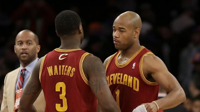 Cleveland Cavaliers' Jarrett Jack, right, and Dion Waiters celebrate after an NBA basketball game against the New York Knicks at Madison Square Garden, Sunday, March 23, 2014, in New York. The Cavaliers defeated the Knicks 106 to 100