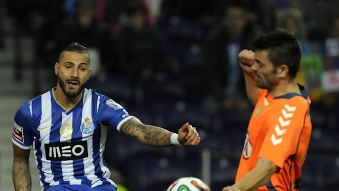 FC Porto's Ricardo Quaresma, left, shoots the ball past Vitoria Setubal's Daniel Soares in a Portuguese League soccer match at the Dragao Stadium in Porto, Portugal, Sunday, Jan. 19, 2014. Porto won 3-0