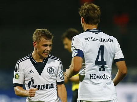Schalke's Meyer and Hoewedes celebrate goal against Darmstadt 98 during their German soccer cup second round match in Darmstadt,