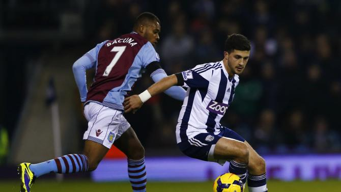 West Bromwich Albion's Shane Long is challenged by Aston Villa's Leandro Bacuna during their English Premier League soccer match at The Hawthorns in West Bromwich