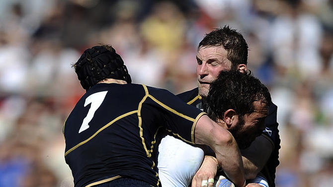 Italy's Fabio Ongaro (C) is tackeld by Scotland's John Barclay and Ross Rennie (L) during their Rugby Union Six Nations match at the Rome's Olympic stadium on March 17, 2012. Italy defeated Scotland 13-6.  AFP PHOTO / FILIPPO MONTEFORTE (Photo credit should read FILIPPO MONTEFORTE/AFP/Getty Images)