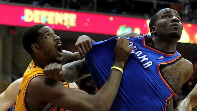 Cleveland Cavaliers Tristan Thompson battles for position with Oklahoma City Thunders Kendrick Perkins during the seond quarter of their NBA basketball game in Cleveland