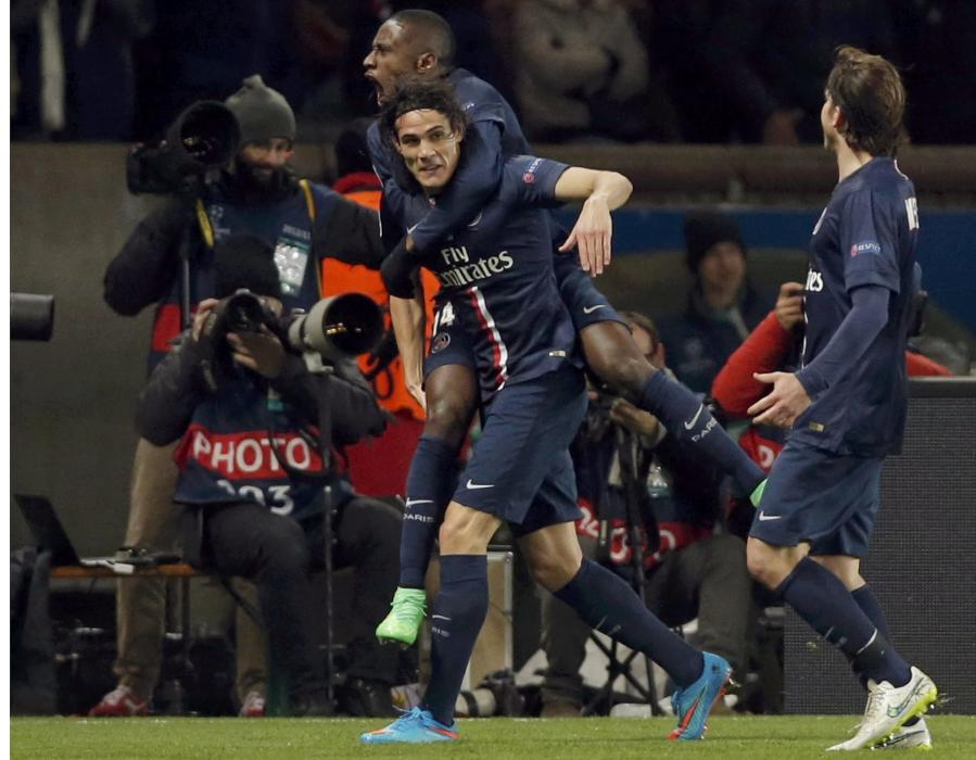 Paris St Germain's Edinson Cavani reacts after scoring a goal with teammate Blaise Matuidi during their Champions League round of 16 first leg...