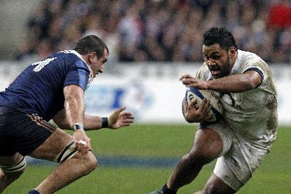 England's Billy Vunipola runs with the ball as France's Yoann Maestri tries to stop him, during their Six Nations rugby union international match, at the Stade de France, in Saint Denis, outside Paris, Saturday, Feb 1, 2014. France defeated England 26-24
