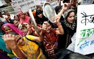 Women protest against the passage of foreign direct investment in multi-brand retail outside the Agriculture Ministry in New Delhi. The policy changes unveiled last week include allowing in foreign direct investment from retail giants such as Walmart and Tesco, as well foreign airlines