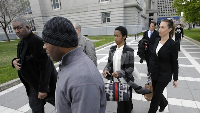 "Singer Lauryn Hill, center, walks from federal court in Newark, N.J., Monday, April 22, 2013, after a judge postponed her tax evasion sentencing and scolded the eight-time Grammy winner for reneging on a promise to make restitution. Hill pleaded guilty last year to not paying federal taxes on $1.8 million earned from 2005 to 2007. At that time, her attorney said she would pay more than $500,000 by the time of her sentencing. It was revealed Monday in court that Hill has paid $50,000. The South Orange resident got her start with The Fugees and began her solo career in 1998 with the acclaimed album ""The Miseducation of Lauryn Hill."" (AP Photo/Mel Evans)"