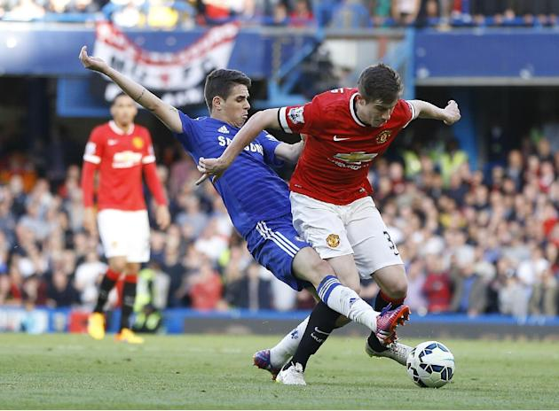 FILE - In this April 18, 2015, file photo, Chelsea's Oscar, left, vies for the ball with Manchester United's Paddy McNair during the English Premier League soccer match between Chelsea and Man