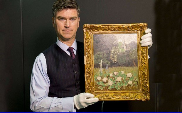 Christopher Marinello holding the recovered Le Jardin by Matisse