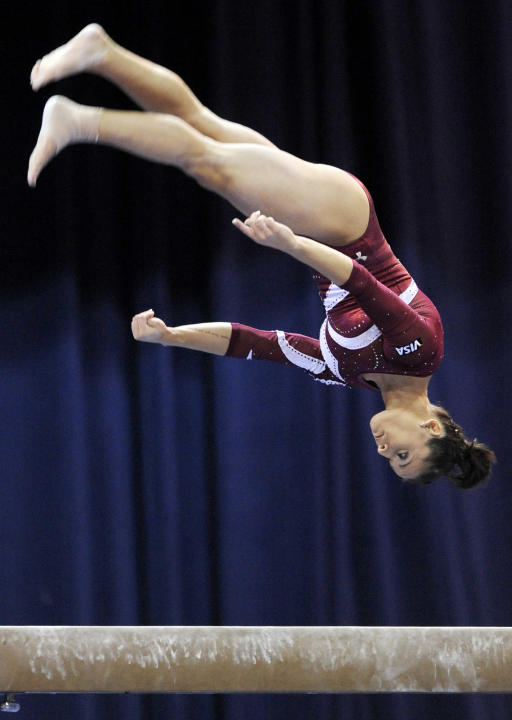 Alicia Sacramone competes on the balance beam during the Covergirl Classic gymnastics competition in Chicago, Saturday, July 23, 2011. The 2011 CoverGirl Classic is the final qualifying event for the