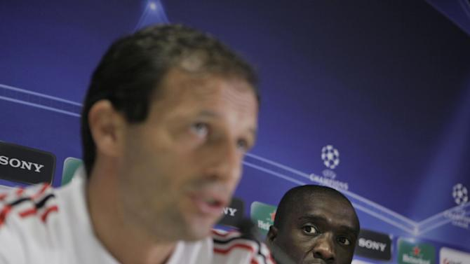 In this Sept. 27, 2010 file photo, AC Milan coach Massimiliano Allegri, left, and player Clarence Seedorf answer questions during a press conference at the ArenA stadium in Amsterdam, Netherlands. Clarence Seedorf said Tuesday he will take over as the new coach at AC Milan, replacing Massimiliano Allegri who was fired on Monday. Seedorf made the announcement at Brazilian club Botafogo, where he has been playing