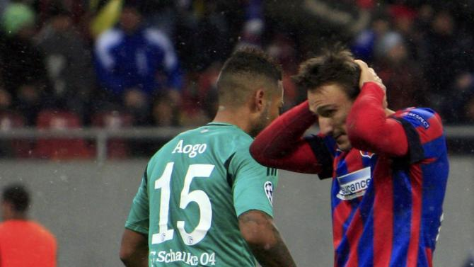 Steaua Bucharest's Piovaccari reacts as he missed a chance to score a goal against Schalke 04 during their Champions League soccer match in Bucharest